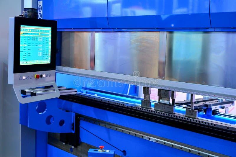 Metalworking bending machine for sheet metal blanks. Background royalty free stock image
