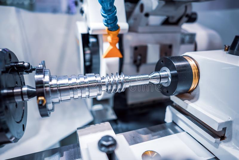 Metalworking CNC milling machine. Cutting metal modern processing technology. Small depth of field. Warning - authentic shooting in challenging conditions. A royalty free stock photography