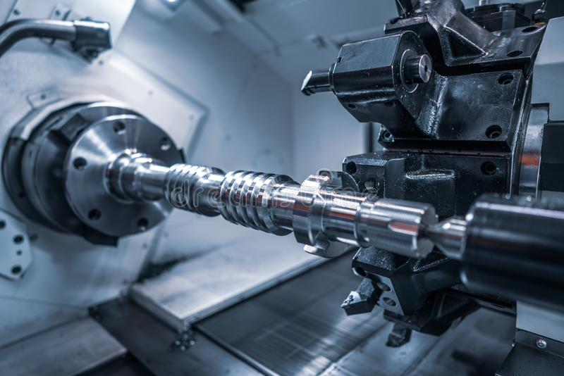 Metalworking CNC milling machine. Cutting metal modern processing technology. Small depth of field. Warning - authentic shooting in challenging conditions. A royalty free stock images