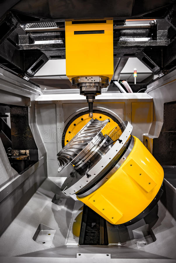 Metalworking CNC milling machine. Cutting metal modern processing technology. Small depth of field. Warning - authentic shooting in challenging conditions. A stock photography