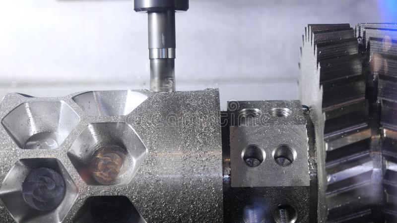 Metalworking cutting process by milling cutter. Media. CNC machine processes metal detail. Close-up of the metal royalty free stock images