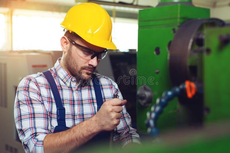Metalworking Industry Job. Caucasian Lathe Operator Worker. royalty free stock photo