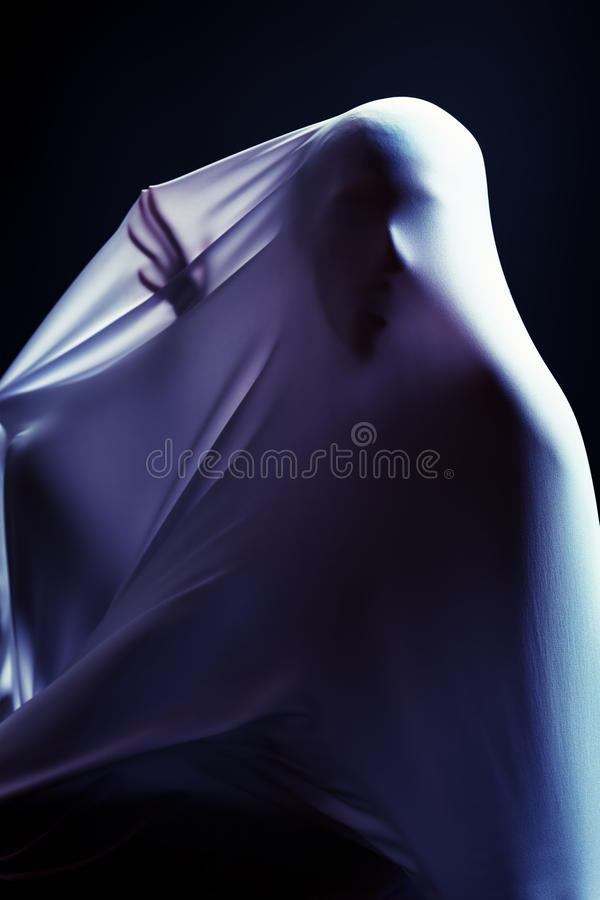 Metaphor. Art photo of a female silhouette breaking through the fabric. Struggle concept royalty free stock photos