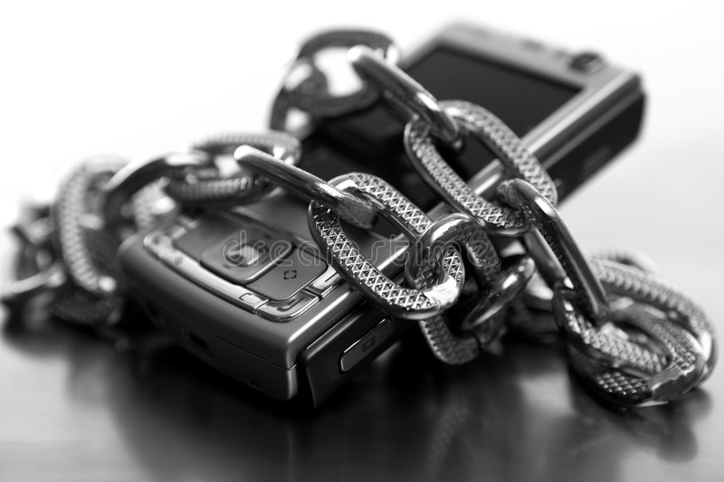 Metaphor of being slave to the mobile phone royalty free stock photography