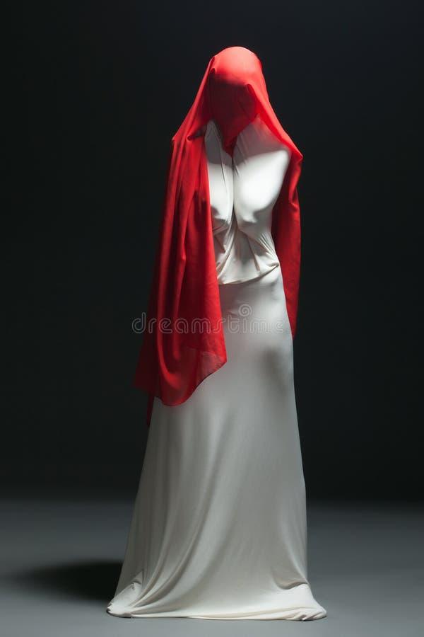 Metaphor for loneliness - faceless female dancer stock photo