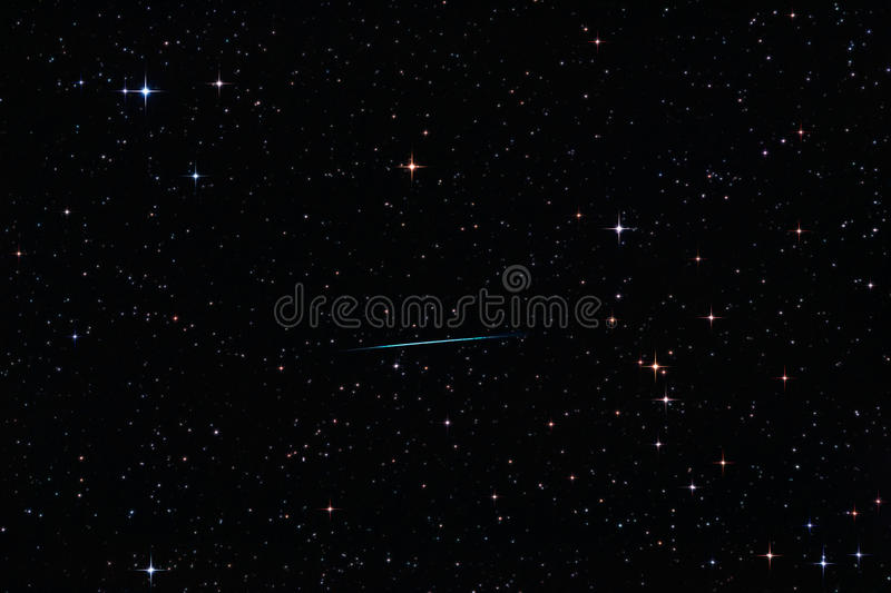 Meteor crossing the starry sky stock images