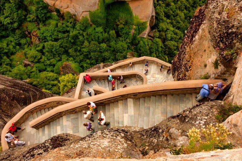 METEORA, GREECE - JUNE, 2011: Stairs of Varlaam monastery. METEORA, GREECE - JUNE, 2011: Tourosts go down the stairs of Varlaam monastery, holy place in stock image