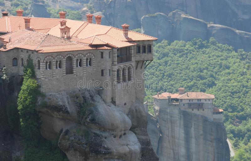 Meteora in Greece. Meteora literally in the middle of the air from the greek META ' in the middle and AER air, suspended in the air or in the heavens above) is a stock images