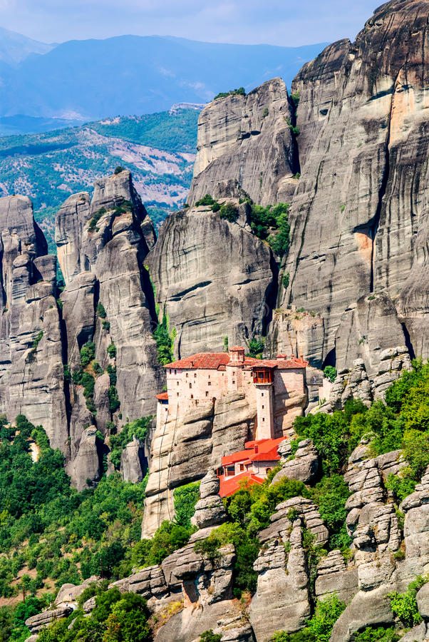 Meteora, Greece. Mountain scenery with Meteora rocks and Roussanou Monastery, landscape place of monasteries on the rock, orthodox religious greek landmark in royalty free stock photography