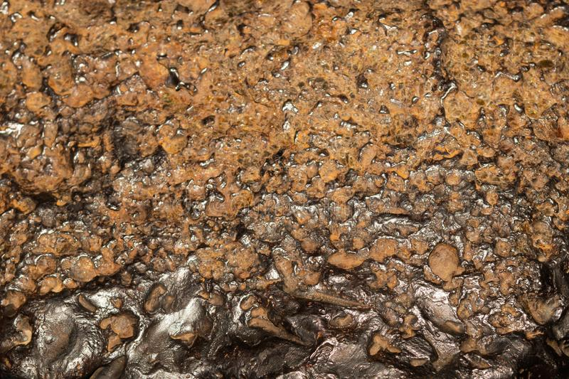 Meteoritbeschaffenheitshintergrund Meteoritoberflächenabschluß oben lizenzfreie stockfotografie