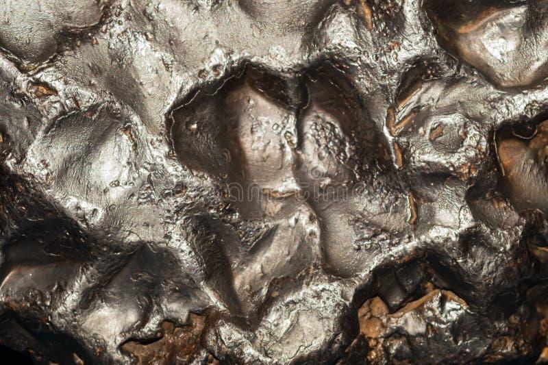 Meteoritbeschaffenheitshintergrund Meteoritoberflächenabschluß oben lizenzfreie stockfotos