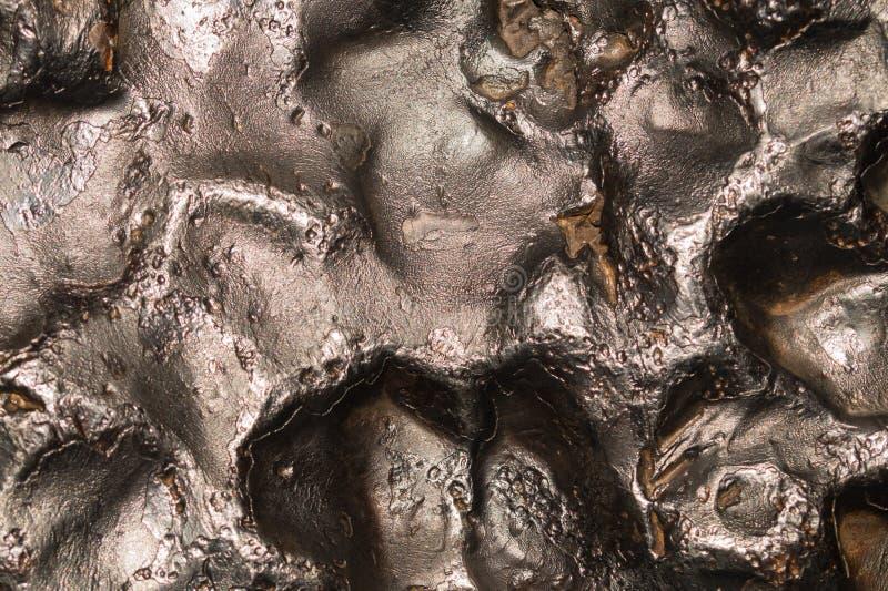 Meteoritbeschaffenheitshintergrund Meteoritoberflächenabschluß oben stockfotografie