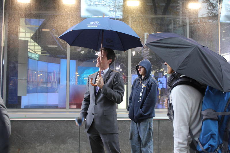 Meteorologist Jeff Smith reporting Hurricane Sandy. Meteorologist for WABC-TV, in New York, Jeff Smith, reporting weather conditions in the aftermath of royalty free stock image