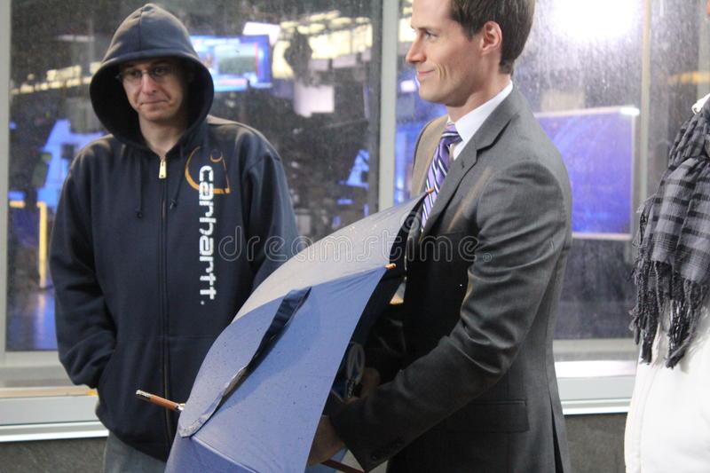 Meteorologist Jeff Smith reporting Hurricane Sandy. Meteorologist for WABC-TV, in New York, Jeff Smith, reporting weather conditions in the aftermath of royalty free stock photo
