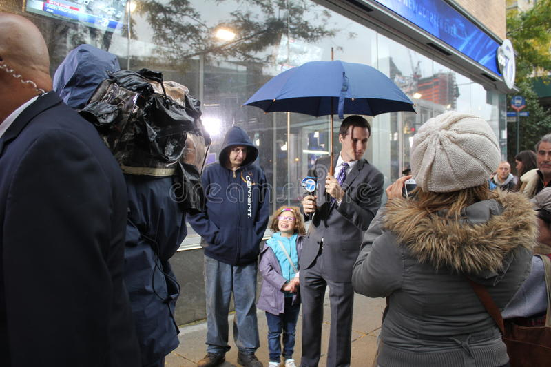 Meteorologist Jeff Smith reporting Hurricane Sandy. Meteorologist for WABC-TV, in New York, Jeff Smith, reporting weather conditions in the aftermath of royalty free stock images