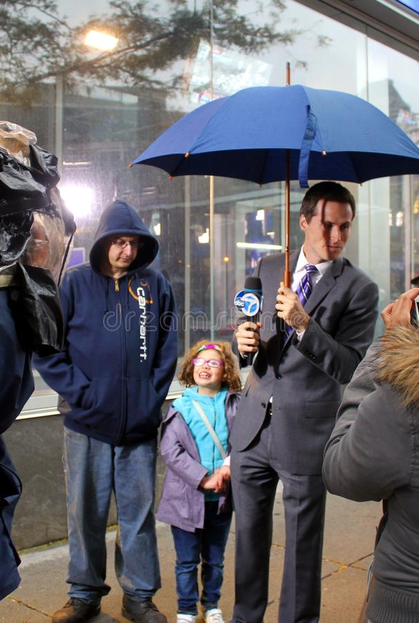 Meteorologist Jeff Smith reporting Hurricane Sandy. Meteorologist for WABC-TV, channel 7, in New York, Jeff Smith, reporting weather conditions and interviewing stock photo