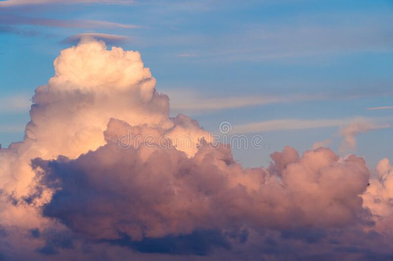 Sunset sky cloudscape cumulus cumulonimbus cloud weather heaven cloudy air thunderstorm fluffy climate overcast flying high blue stock photos