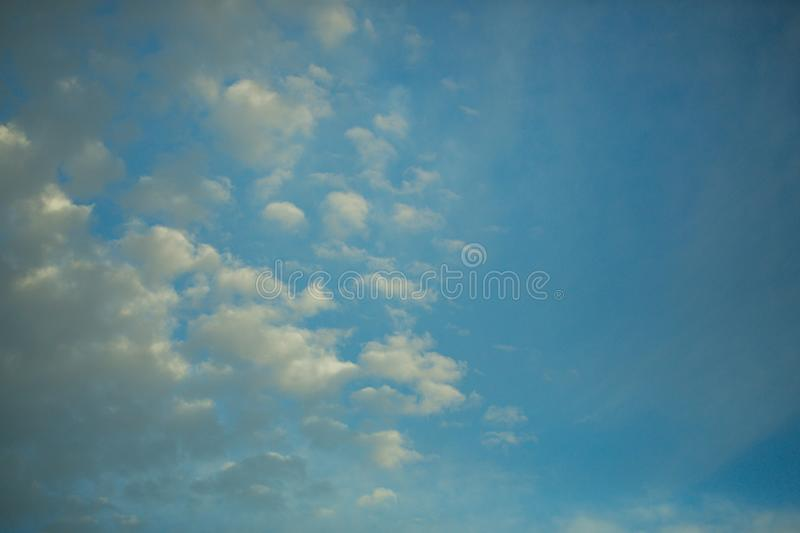 Meteorology, weather, climate. Blue sky with white clouds. Nature, environment, ecology. Cloudscape condensation cumulus Freedom wanderlust vacation concept royalty free stock image