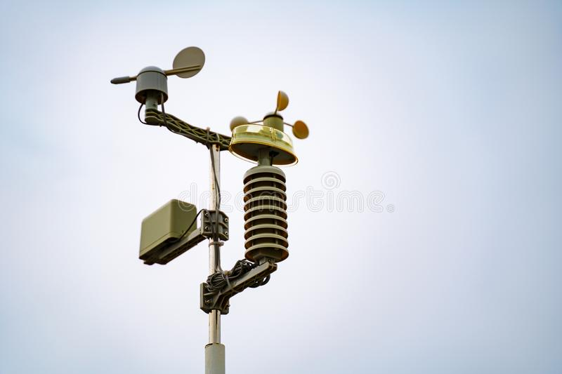 Meterological weather station wind meter anemometer on sky background.  stock images