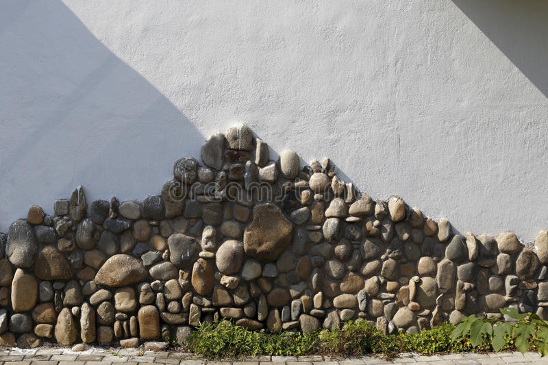The metope of cobble mosaic. House unique decorative wall, break the monotony stock photography