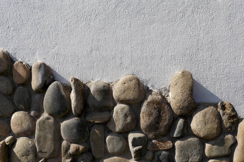 The metope of cobble mosaic. House unique decorative wall, break the monotony stock images