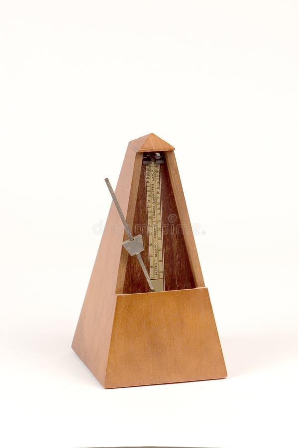 Metrônomo de madeira imagem de stock royalty free