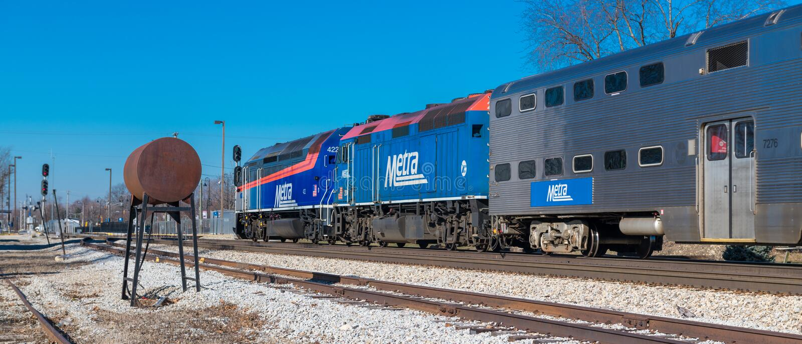 Metra commuter train arrives in Mokena from Chicago. Metra commuter train arrives in Mokena toward Joliet and from Chicago stock photos