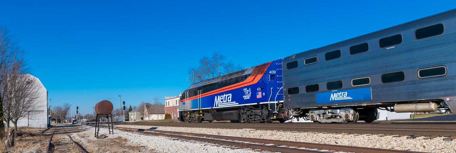Metra commuter train arrives in Mokena. Toward Joliet and from Chicago stock photography