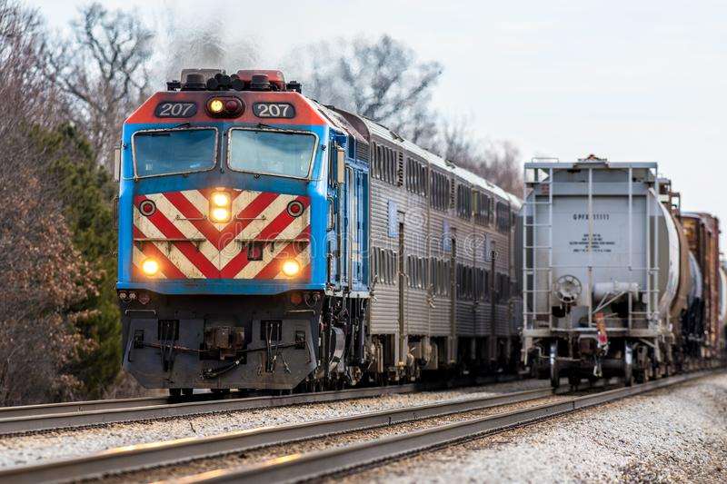 Metra commuter train passes freight train east of Joliet. Illinois on double main line royalty free stock photography