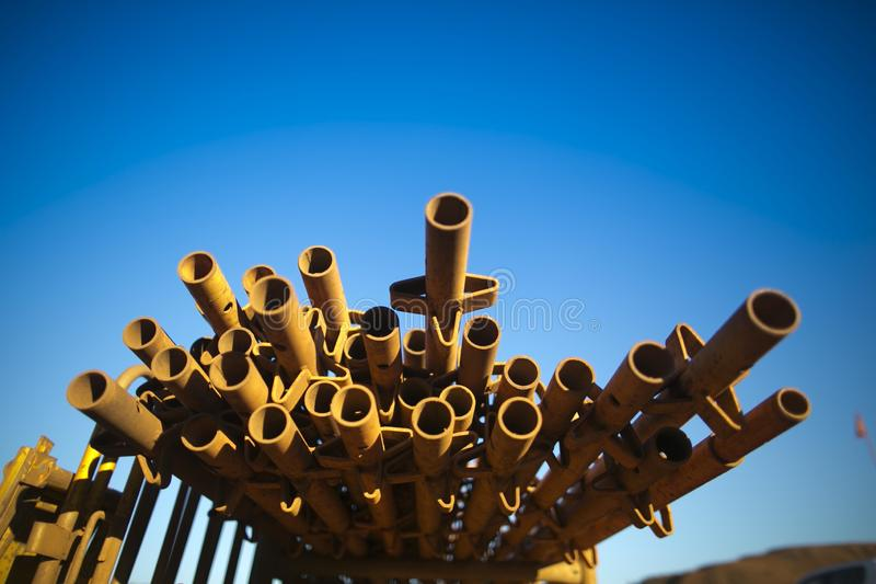 2 metre standing standard round steel scaffold tubes stack on top of each other at laydown yard stock photo