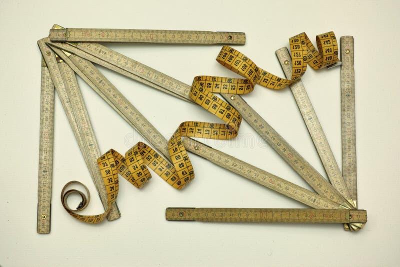 Metri per i carpentieri, natura morta fotografie stock libere da diritti