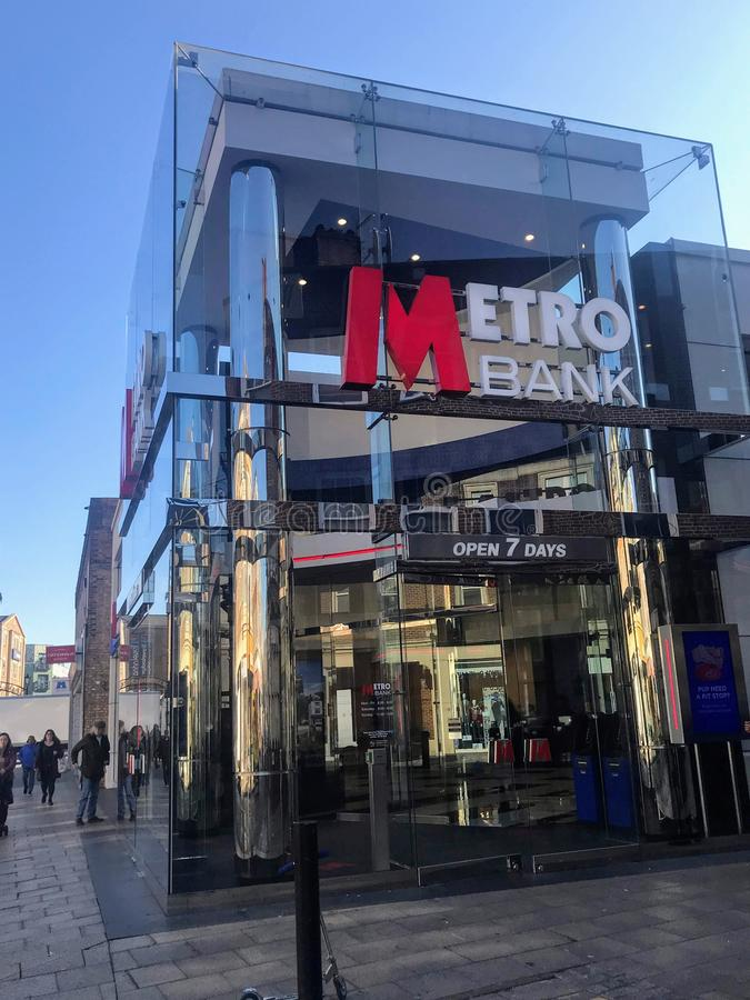 Metro Bank branch. Metro Bank plc is a retail bank operating in the United Kingdom, founded by Anthony Thomson and Vernon Hill in 2010. At its launch it was the royalty free stock image
