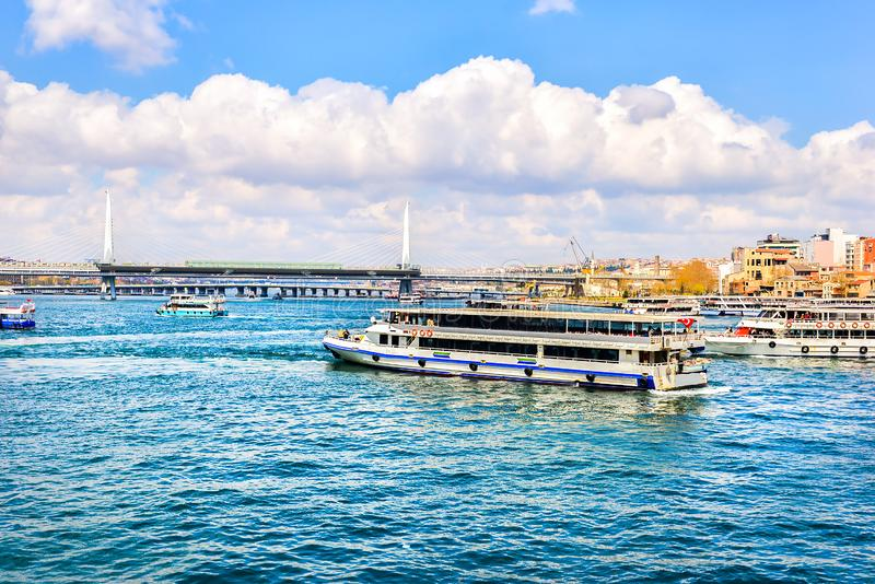 Metro bridge and boats. Metro bridge and touristic boats on Bosphorus in Golden Horn, Istanbul stock photography