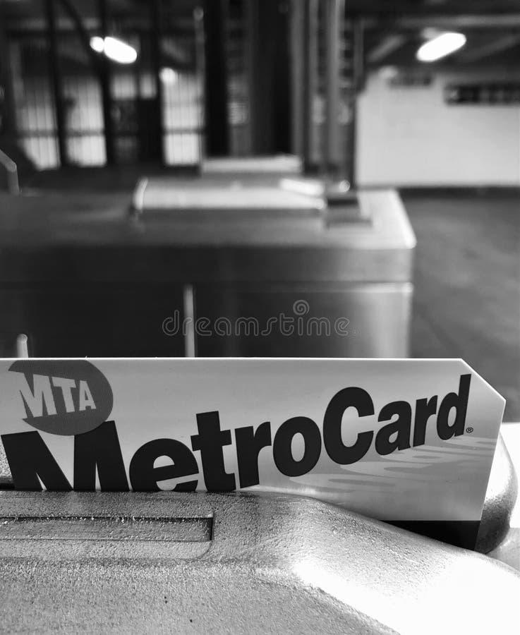 Metro Card Swiping Turnstile Machine New York City Subway Metrocard Paying Fare. MTA royalty free stock image