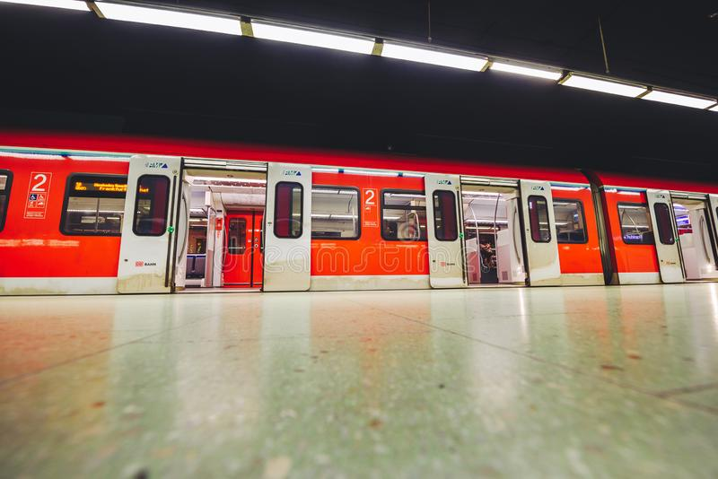 Metro chasing underground station, Frankfurt, Germany. FRANKFURT, GERMANY - OCTOBER 07, 2016: Metro stopped Frankfurt am Main Hbf station stock image