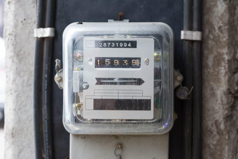 Metro de la electricidad del kilovatio-hora, metro de la fuente de alimentación, símbolo de la hora fotos de archivo libres de regalías