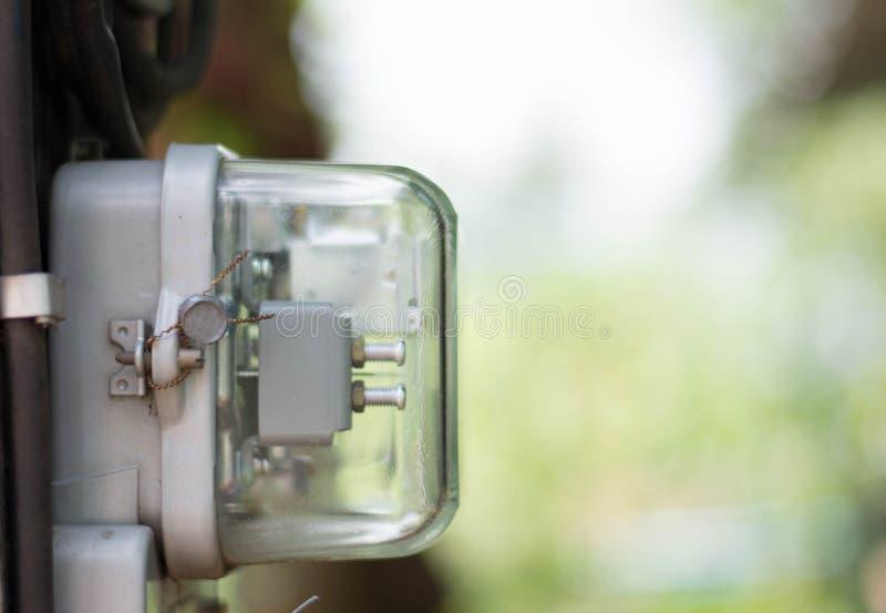 Metro de la electricidad del kilovatio-hora, metro de la fuente de alimentación, símbolo de la hora fotografía de archivo
