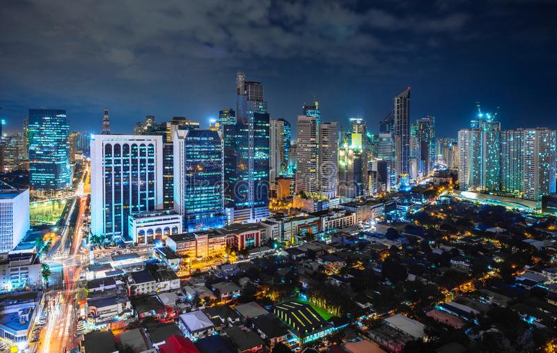 Metro Manila cityscape at night. With high rise buildings in line royalty free stock photography