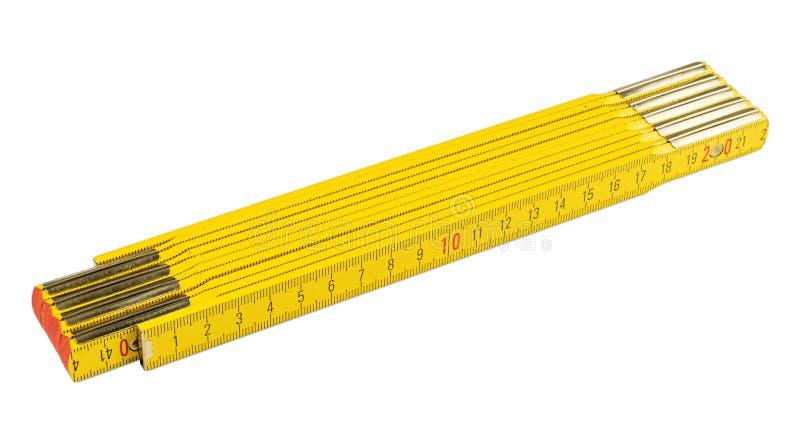 Metro plegable amarillo fotos de archivo libres de regalías