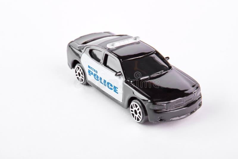 Metro police car toy, white background. Black and white metal police car toy isolated on white background stock image
