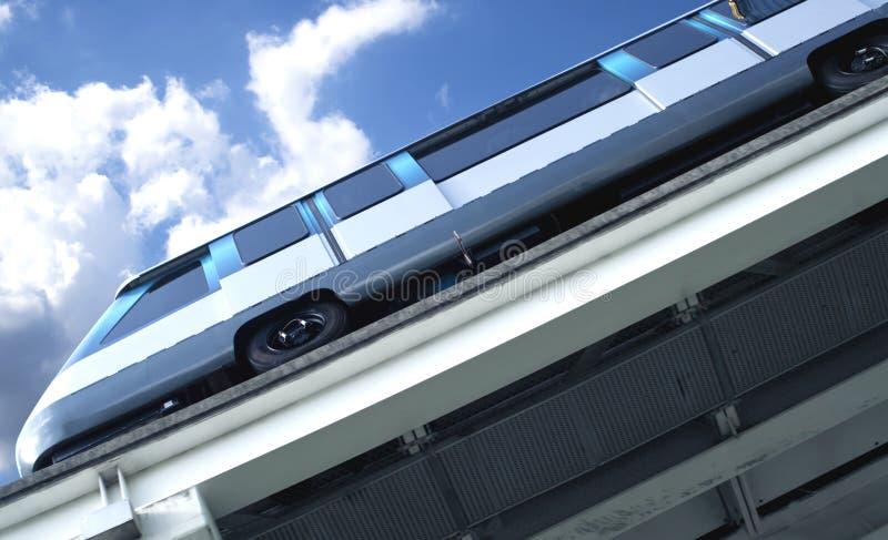 Metro rail train. Underside angle of downtown metro rail train car against bright blue sunny sky royalty free stock photo