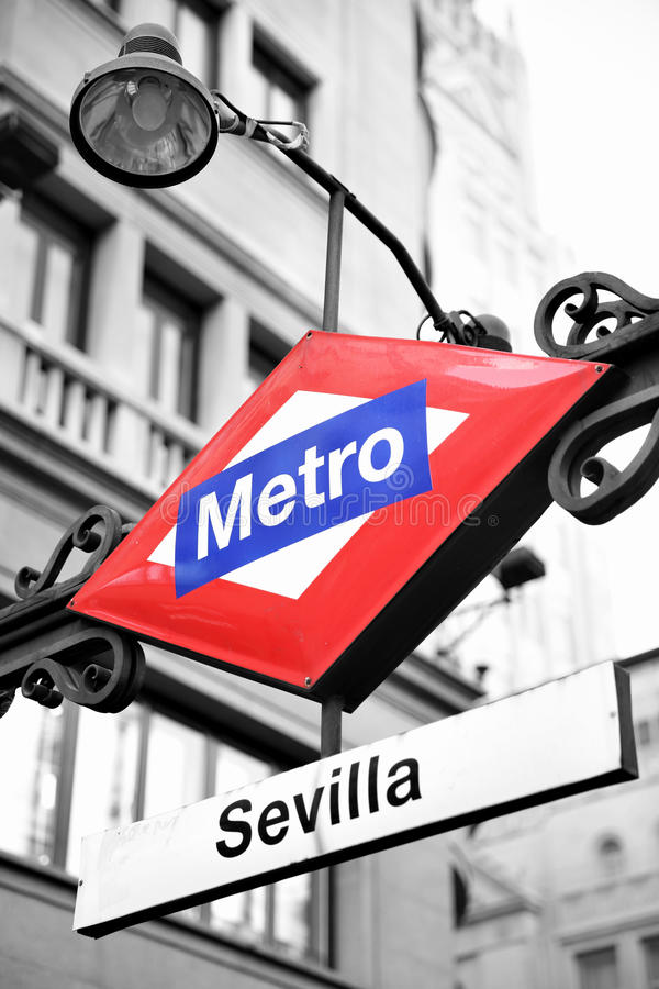 Metro sign in Madrid. Sevilla station. Partly black and white image royalty free stock images