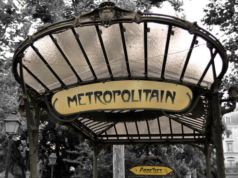 Metro sign in Paris - Abbesses. PARIS, FRANCE - 20 August 2014: The entrance to the Abbesses station for the Paris Metro. Famous art nouveau built in 1912 and royalty free stock photo