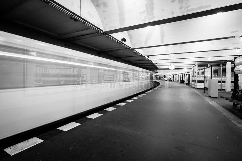 Metro station. The arrival of the train. Motion blur. Black and white stock image