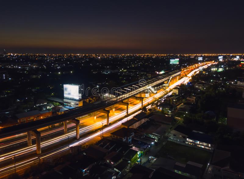 Metro station in the middle of the city at night.High angle view. Focus at the BTS station royalty free stock image