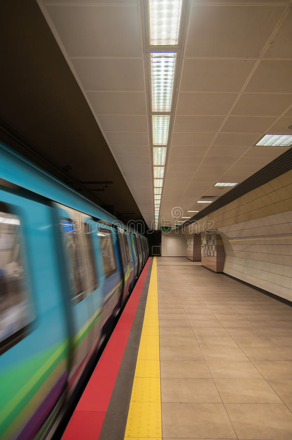 Metro Station. Vertical photo of a metro station and moving wagon. There are colorful lines and noone is visible in the peron royalty free stock images