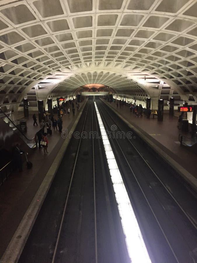 Metro Subway Station In Washington DC. Inside look at brightly lit Metro / Subway station in our Nations Capital, Washington DC. Metro rail is seen inside the stock photography