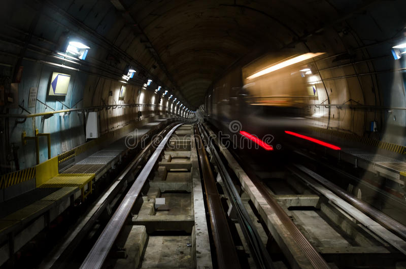 Metro subway of turin. Italy with dark tunnel and a train moving fast stock photo