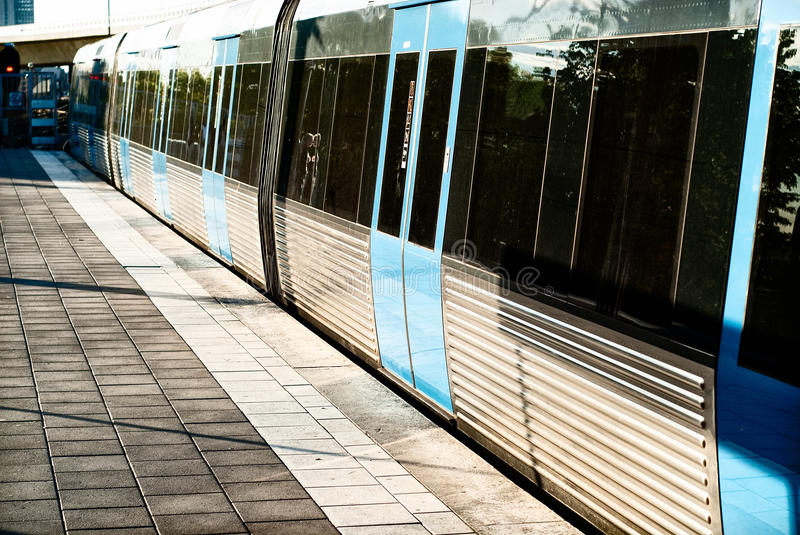 Metro train at platform. A metro train at a deserted platform royalty free stock image