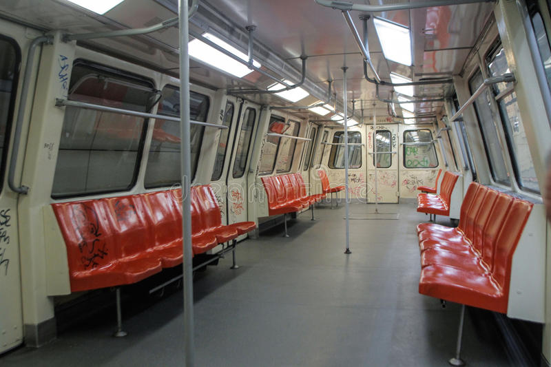 Metro wagon. BUCHAREST, ROMANIA, June 10, 2016: The interior of a metro wagon with red chairs in a metro station in Bucharest stock photos